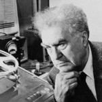 Edgar Varese looking at an early tape machine